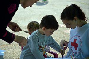 Wolontariuszka z dzieckiem